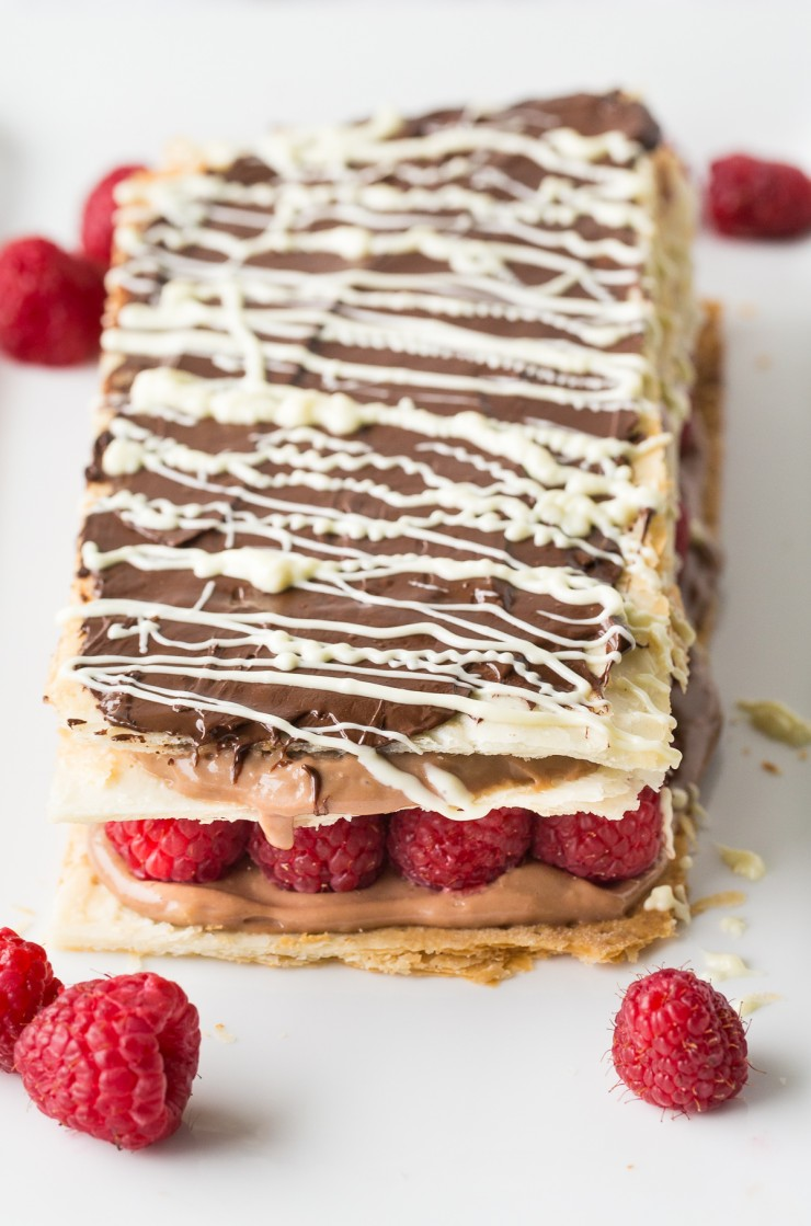 Make a decadent bakery shop treat at home with this indulgent recipe for a Chocolate and Raspberry Napoleon. Fresh raspberries stud chocolate pastry cream layered between airy sheets of puff pastry in this chocolate-raspberry dessert. A match made in heaven!