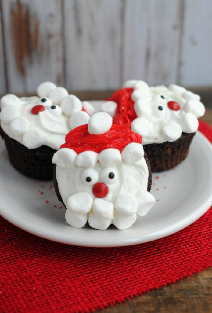 These Santa Claus Cupcakes are great for bringing to a Christmas party - such a fun idea to celebrate this winter holiday!