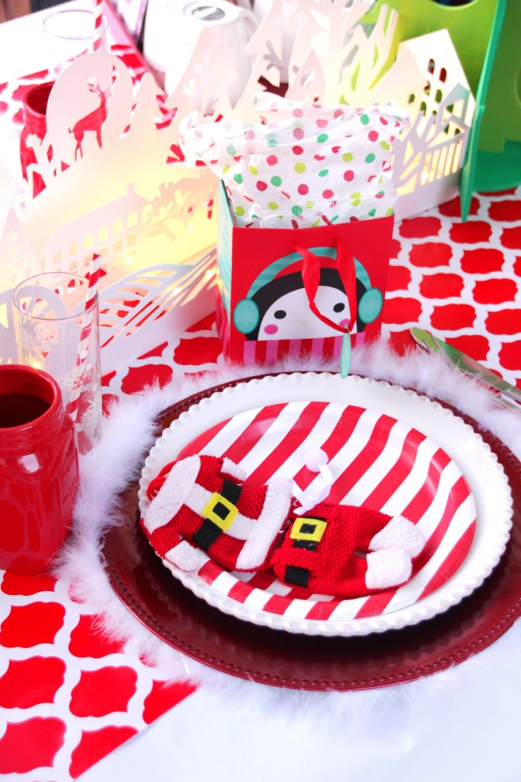 Red white christmas table setting for kids