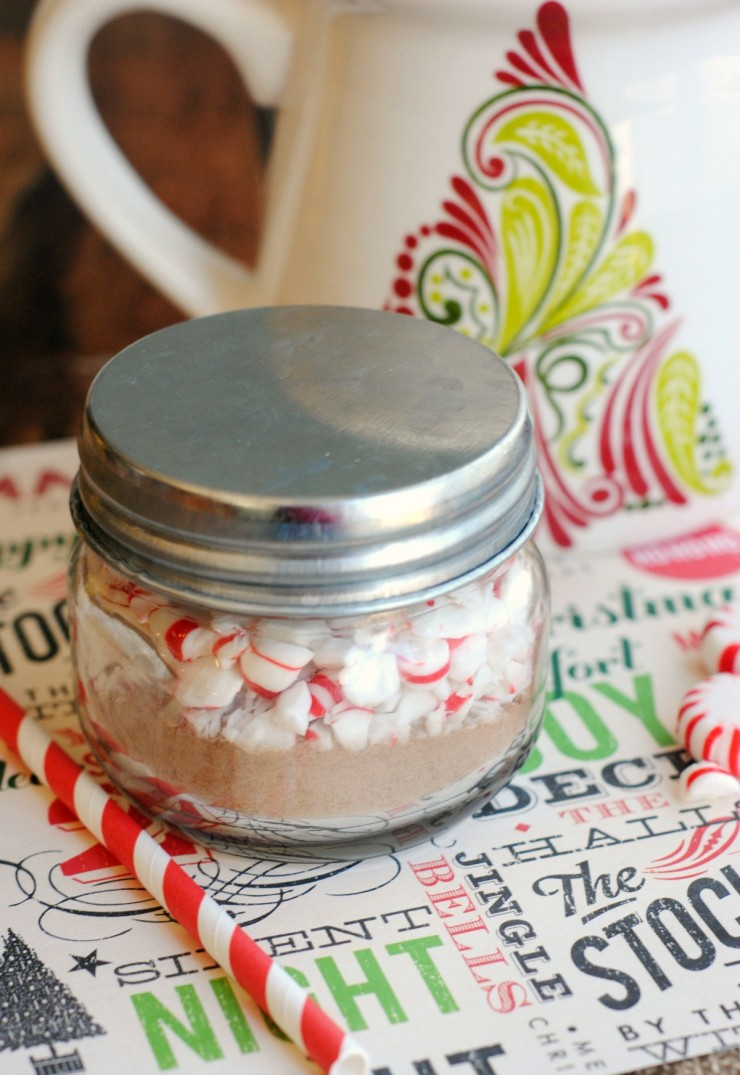 Peppermint Cocoa Mini Gift Jars. Cute, frugal gift idea! Mason jar filled with homemade hot cocoa powder topped with peppermint for a great giftable treat!