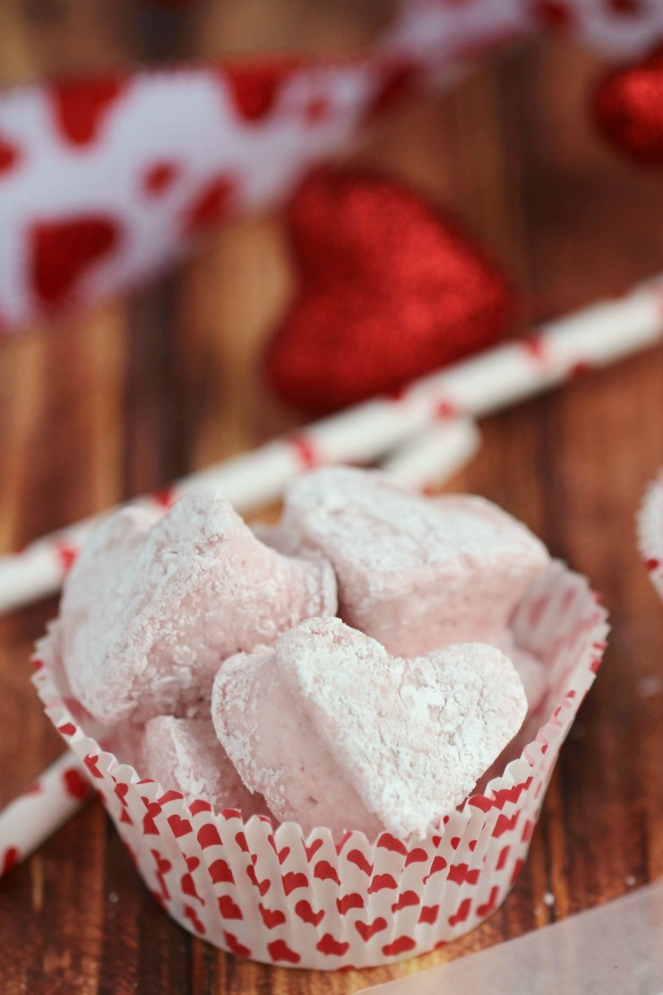 These homemade Cinnamon Heart Marshmallows are soft and squishy with all the flavour of Cinnamon heart candy. An easy-to-make Valentine's Day treat!