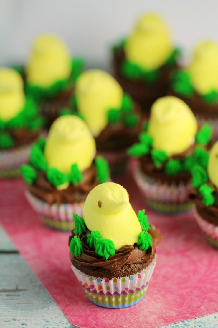 Celebrate Easter with these super easy to make Mini Easter Peeps Cupcakes.  Playful, and portable, these adorable cupcakes are the perfect Easter treat!