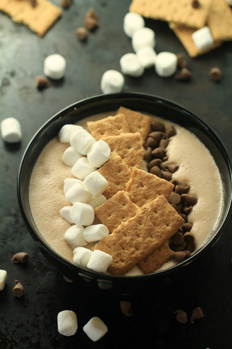 This S'mores Smoothie Bowl is a fun way for everyone to enjoy the taste of a summer camping recipe classic at home.  Your family is going to love this quick and easy dessert recipe!