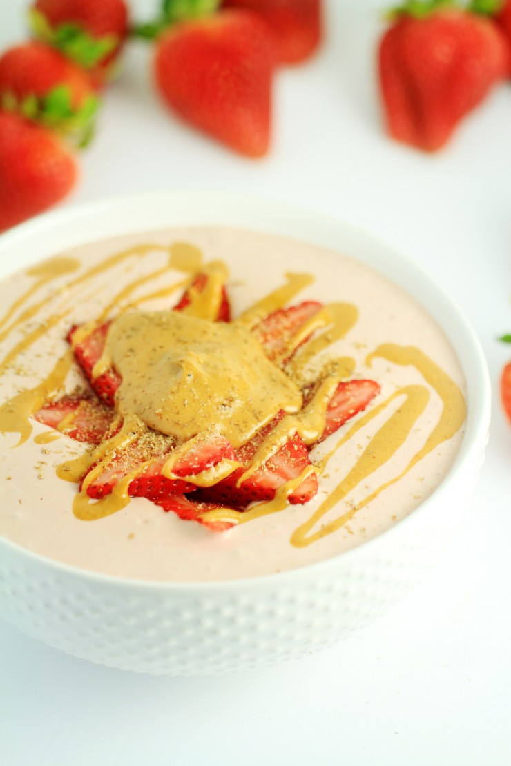 This Peanut Butter and Jelly Smoothie Bowl is a healthy twist on a peanut butter and jelly sandwich.