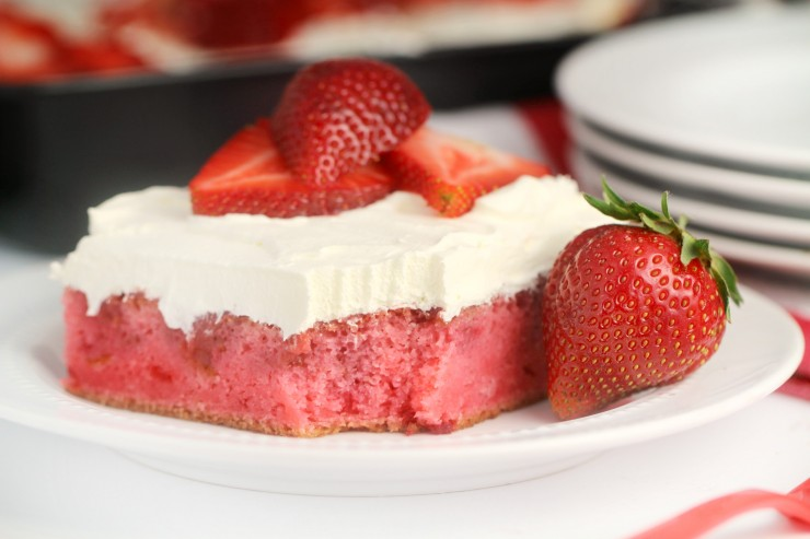 This strawberry poke cake is a delicious twist on that classic summer treat - strawberry shortcake. Fresh strawberries make this the most delicious strawberry cake you've ever had!