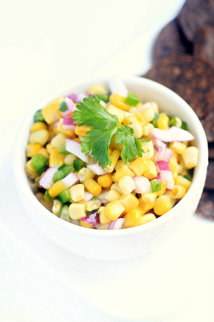 This easy corn salsa recipe will be your new party staple - serve with tortilla chips or with tacos as a delicious condiment.