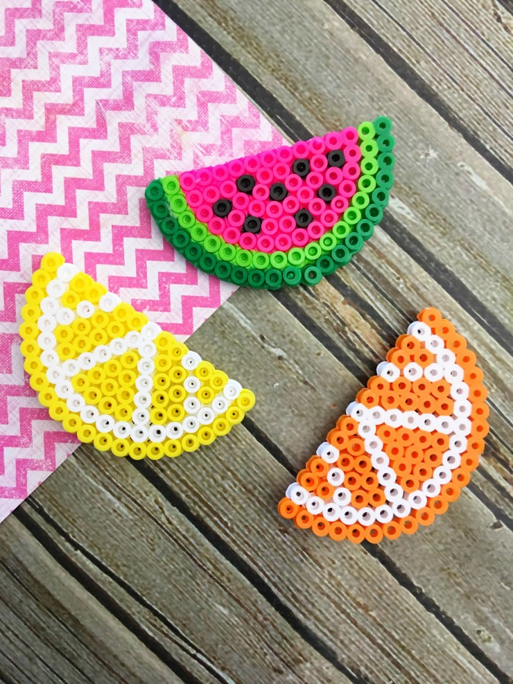 Perler beads are so much fun and are pretty versatile as far as projects you can make with them.  So I'm going to tackle a pretty easy project and share with you how to make perler bead magnets.