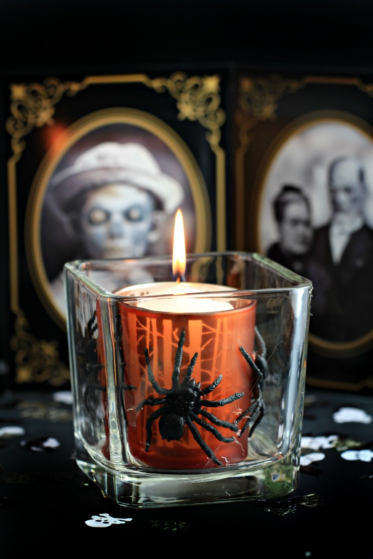 This Halloween Votive is a an easy and spooky Halloween Décor idea that can be made from items founds at the dollar store. Cast a spooky glow on all your Halloween activities with a votive covered in creepy crawlies!