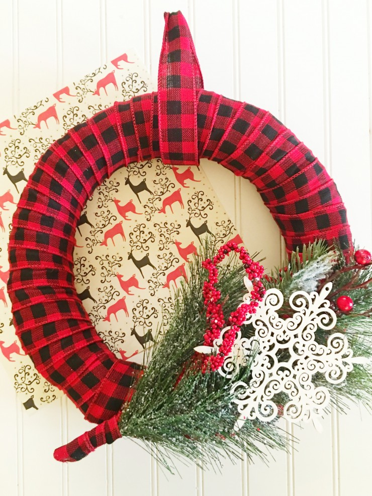 This Plaid Christmas Wreath is a perfect addition to rustic holiday décor. This is a perfect Christmas craft for anyone who loves the look of tartan!