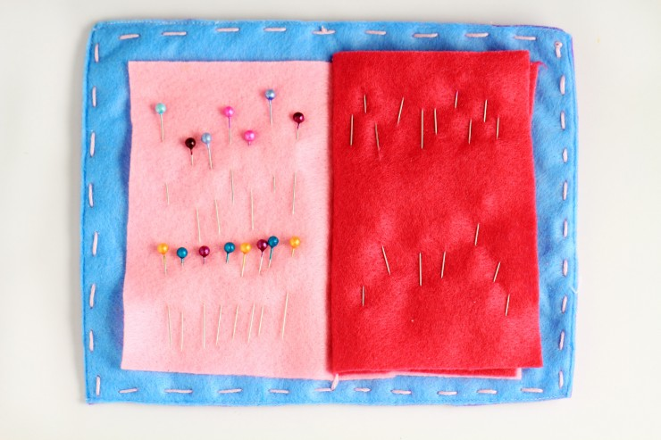 Keep your pins and needles on hand and completely organized in this beautiful handmade felt needle case. A great gift idea for anyone who loves sewing, it is designed like a book with a cover and pages inside for holding pins and needles.