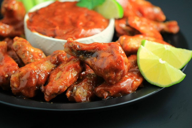 These wings are a little bit sweet with a touch of sweet. They are basically guaranteed to fly off plate at any party you serve these Honey Chipotle Chicken Wings at.