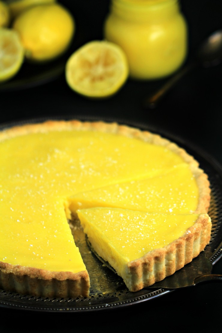 Tart and tangy this lemon tart is deliciously sweet with a shortbread crust that is to die for. This is an impressive from-scratch dessert that is creamy, delicious and easy!