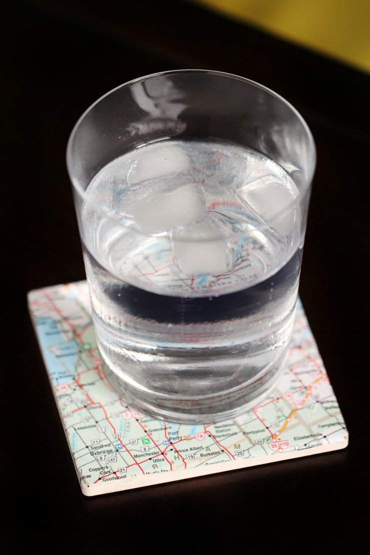Upcycle old maps to create fun and pretty map coasters. Use local maps or maps from your travels to create these diy unique pieces.