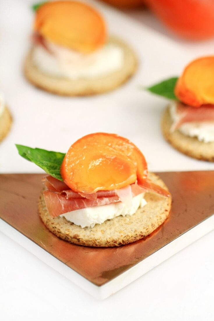 Marinated Persimmon with Prosciutto and Goat Cheese Topped Oatcakes