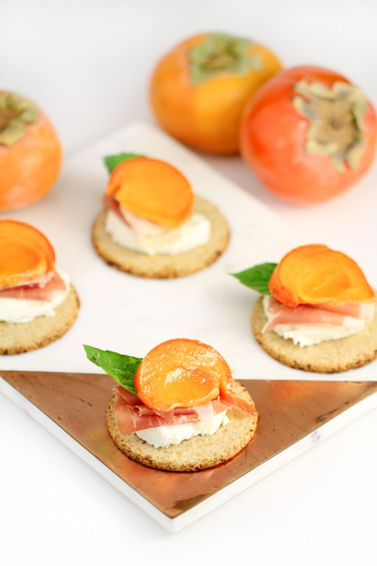 Marinated Persimmon with Prosciutto and Goat Cheese Topped Oatcakes make for a stunning and delicious holiday appetizer. Perfect for Christmas dinner parties or Thanksgiving dinner, your guests will be delighted with the flavour of these hors d'oeuvre .