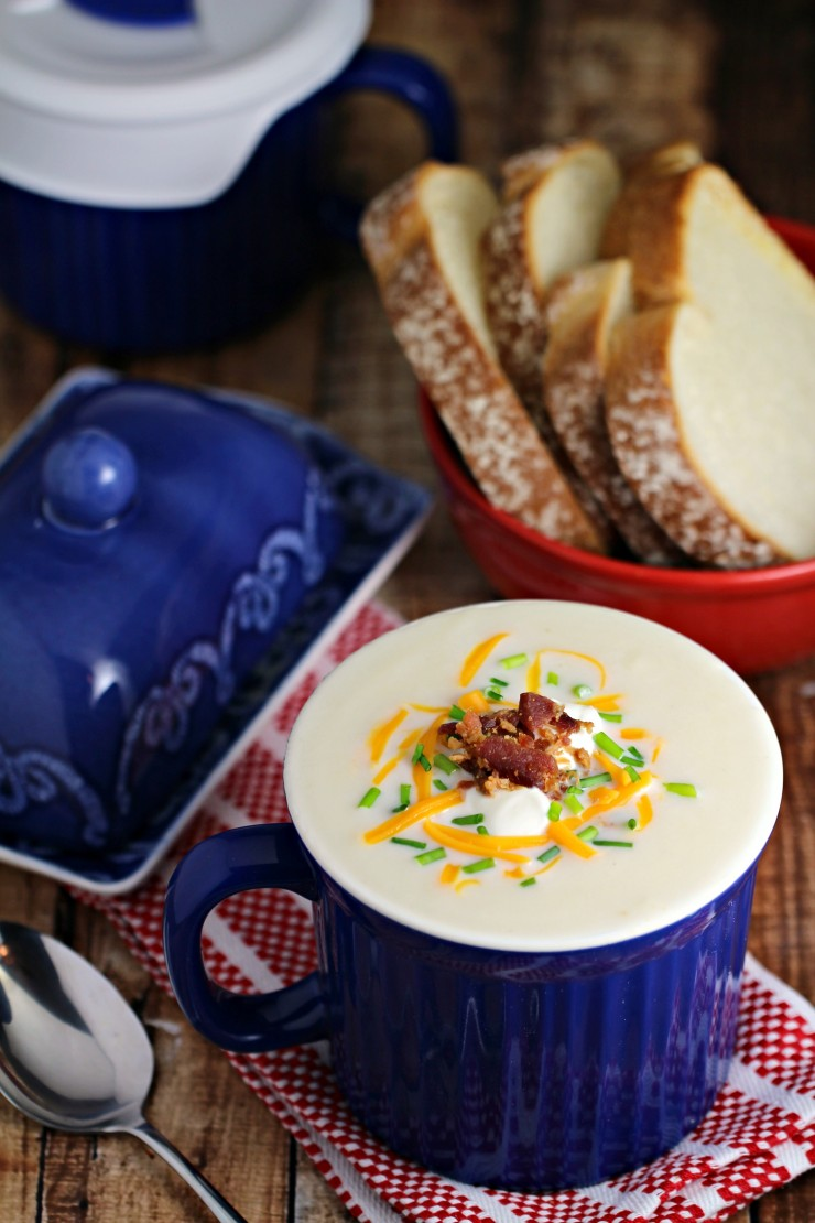 This Microwave Loaded Potato Soup in a Mug is ready in under 5 minutes flat for a delicious, creamy hot meal loaded with delicious toppings like bacon, shredded cheese and more!