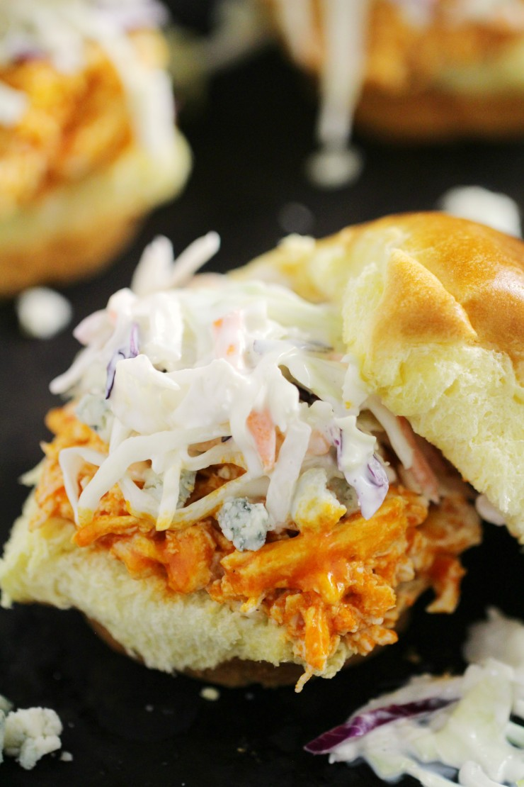 These Quick and Easy Buffalo Chicken Sliders are an easy weeekday meal recipe that easily transition to party appetizer! They come together lightning fast with just a few simple ingredients like shredded chicken, semi-homemade buffalo sauce, and your favourite toppings!