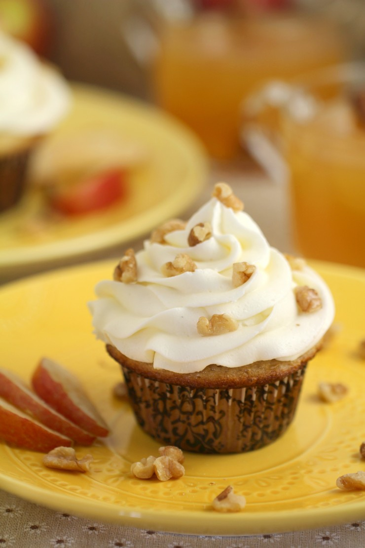 "These Apple Cider Cupcakes are full of fall flavours - warm spices, apple cider, and walnuts come together in this sweet fall dessert. Can we talk about how perfect this and so beyond ""pumpkin spice"" for fall? Yeah. I went there. These cupcakes are way yummier."