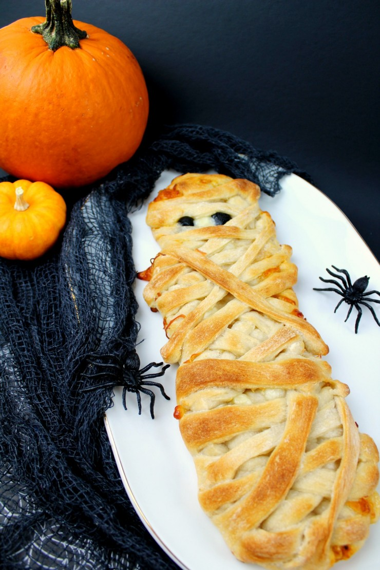 These Mummy Calzones are perfect Halloween party food - a delicious and not so spooky meal that kids and adults will enjoy alike.