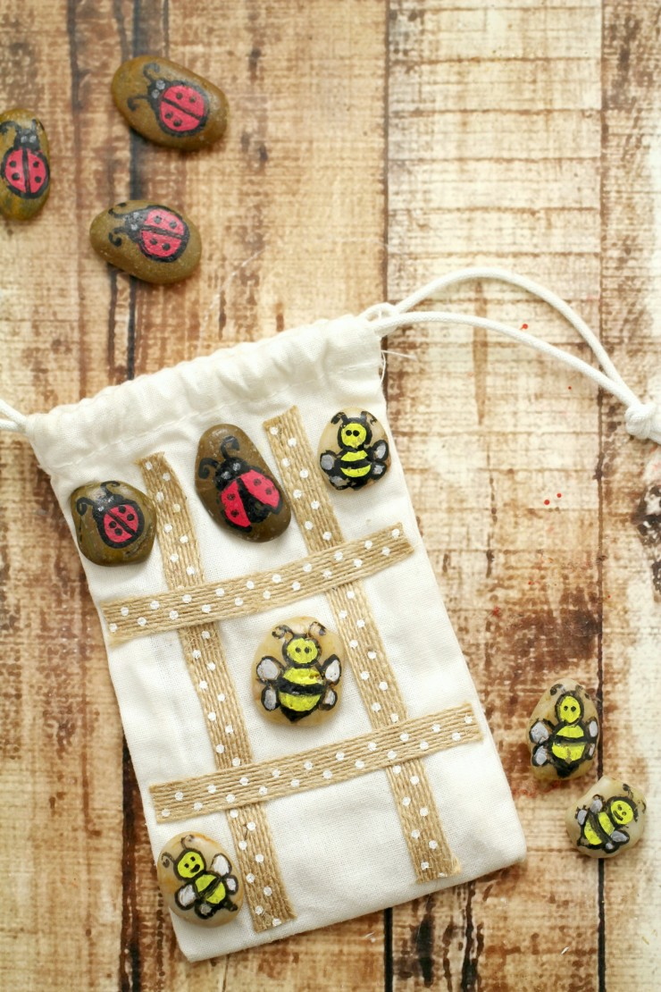 Make your own hand painted tic tac toe travel game to play with at home or on the go. The stone pieces easily store inside their bag which doubles as the play area.