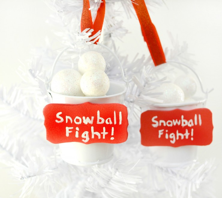 This Snowball Fight Ornament is an easy DIY Christmas project that is honestly just super adorable. This Christmas ornament craft makes great gifts and looks fabulous on a tree.