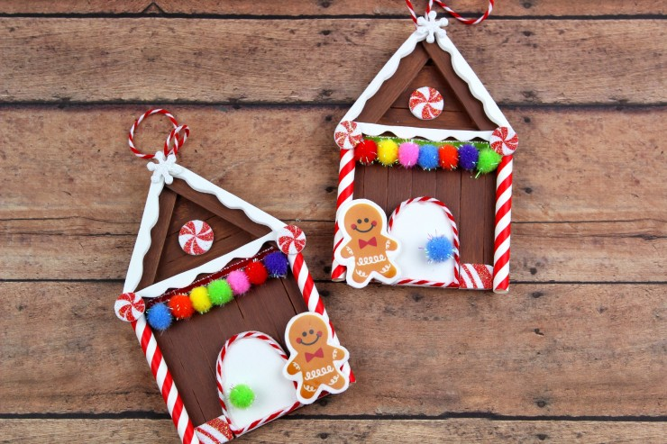These Popsicle Stick Gingerbread House Christmas Ornaments are an adorable and festive holiday craft that make for great keepsake gifts that look great on a Christmas tree. We had so much fun making these Christmas ornaments!