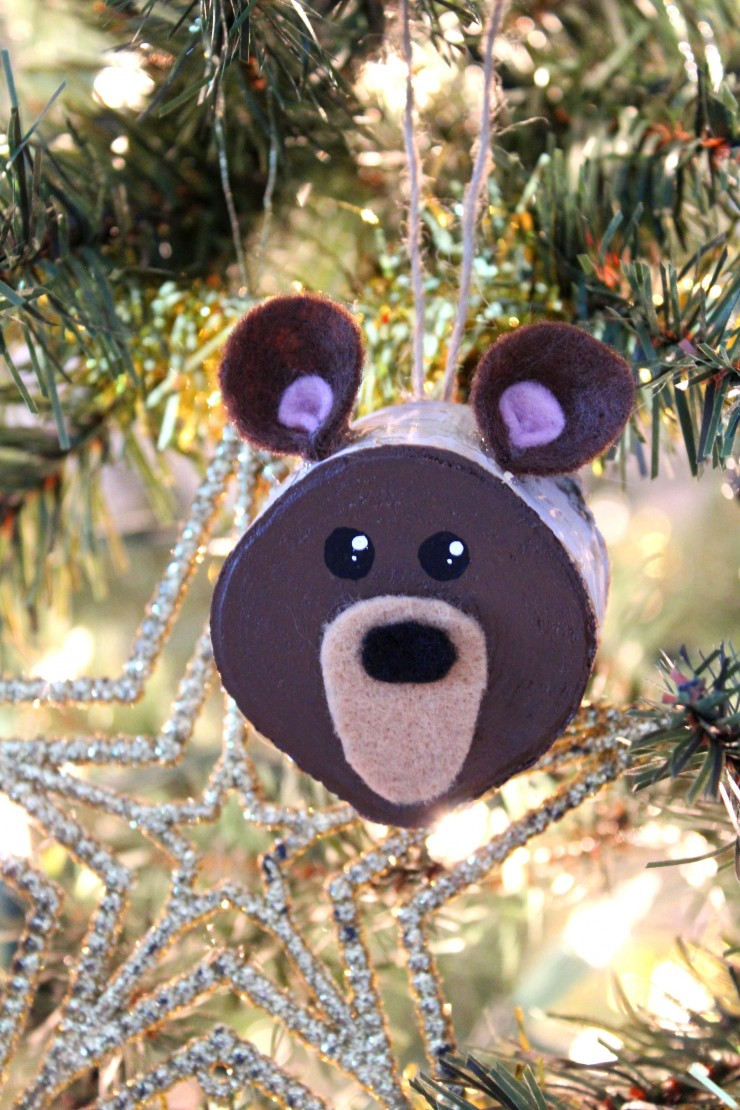 These Wood Slice Brown Bear Ornaments are an easy Christmas ornament craft that results in adorably rustic décor for your tree!