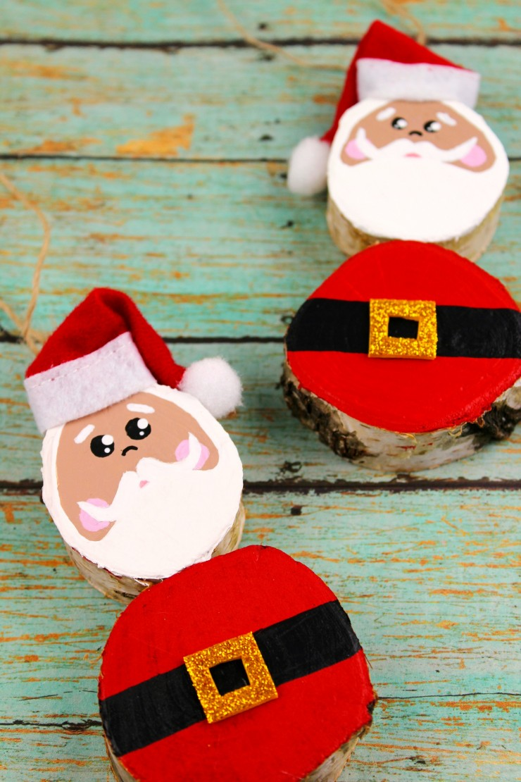 These Wood Slice Santa Claus Ornaments are an adorable and festive holiday craft that make for great keepsake gifts that look great on a Christmas tree.  We had so much fun making these Christmas ornaments!