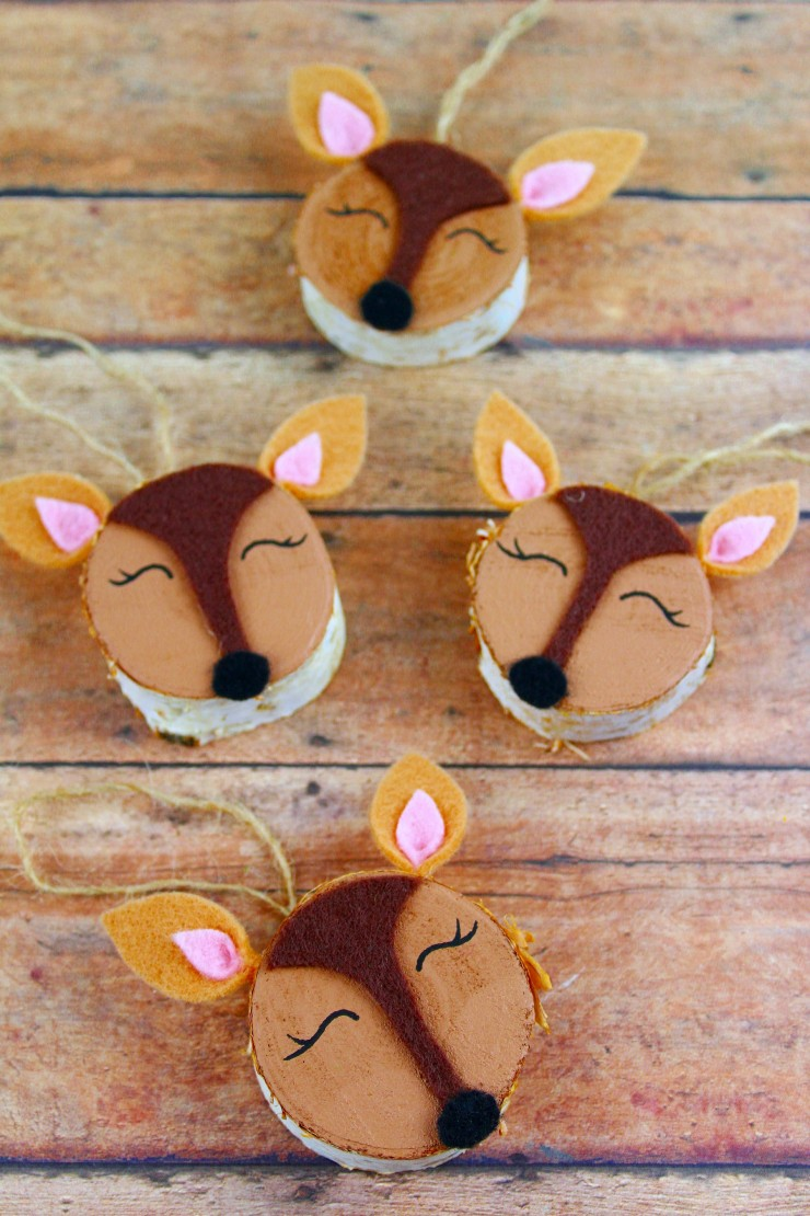 These Wood Slice Woodland Doe Ornaments are an adorable and festive holiday craft that make for great gifts and look great on a Christmas tree. We had so much fun making these rustic Christmas ornaments!