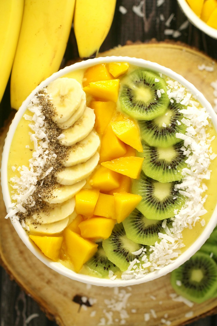 This Mango Banana Smoothie Bowl is a great choice for breakfast with the mellow sweetness of bananas and mango combined with orange juice for an irresistibly fresh bowl.  I like to use Skyr in my breakfast bowls because it adds creaminess and a load of protein but any plain yogurt will work just fine.