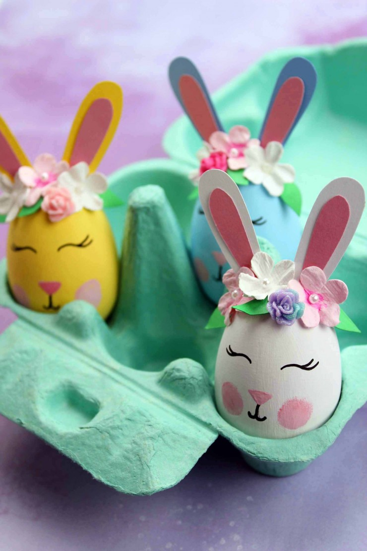 These Bunny Easter Eggs are an easy Easter craft that results in adorable home décor for the Easter season. These bunnies are just the cutest with their floral crowns and rosy cheeks!