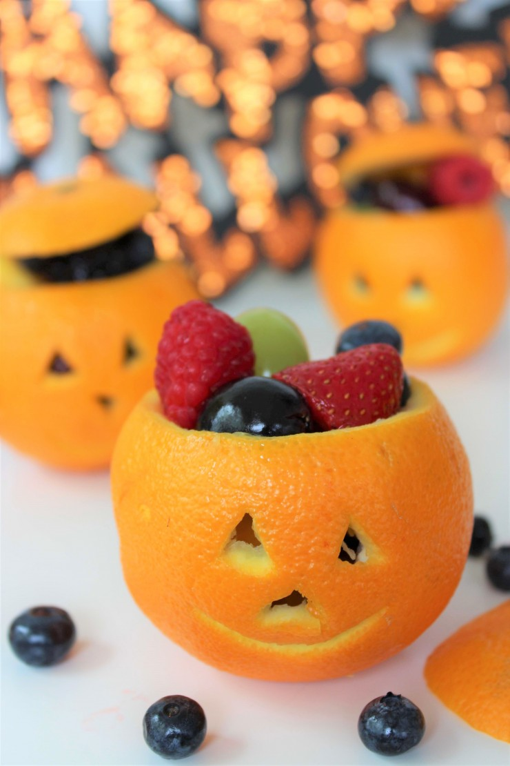These Jack O Lantern Orange Fruit Cups make for a a healthy but festive Halloween treat, perfect for spooky class parties!