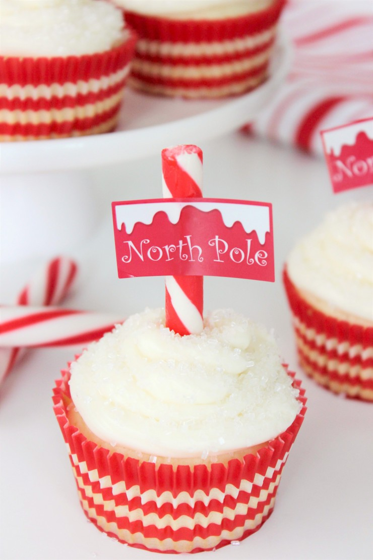 These Sugar Cookie North Pole Cupcakes are as delicious as they are adorably festive. Serve these oh so seasonal cupcakes at Christmas and holiday parties, and watch them get devoured!