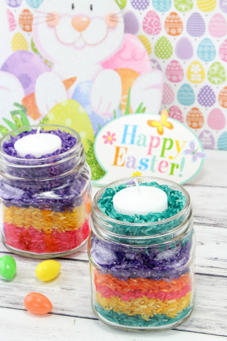 These Easter Rice Candles are super simple and frugal diy Easter tabletop décor your kids can make as soon as they are old enough not to stuff the rice in their face.   Aren't they adorable?