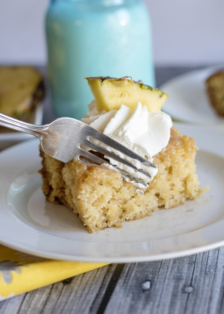 This Pineapple Poke Cake is packed full of tangy sweet flavour that is sure to be a summertime hit.