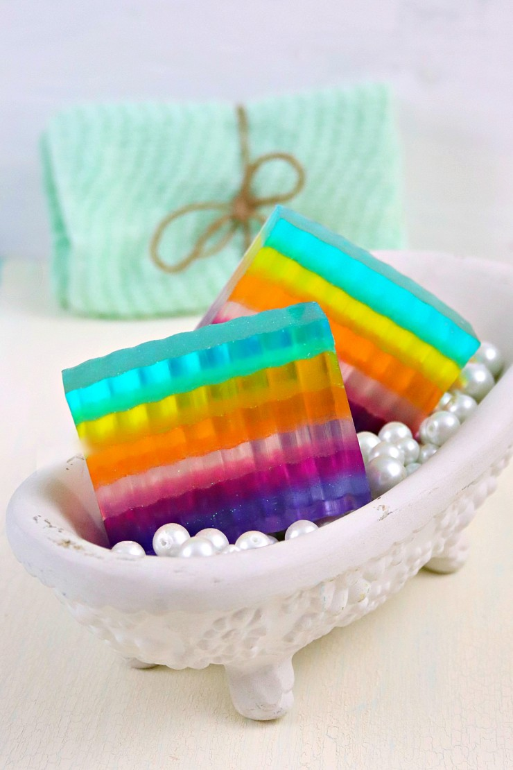 This apple scented DIY Glittery Layered Rainbow Soap is so pretty and perfect. Use at home or give as gifts, this soap is sure to leave you with joy!