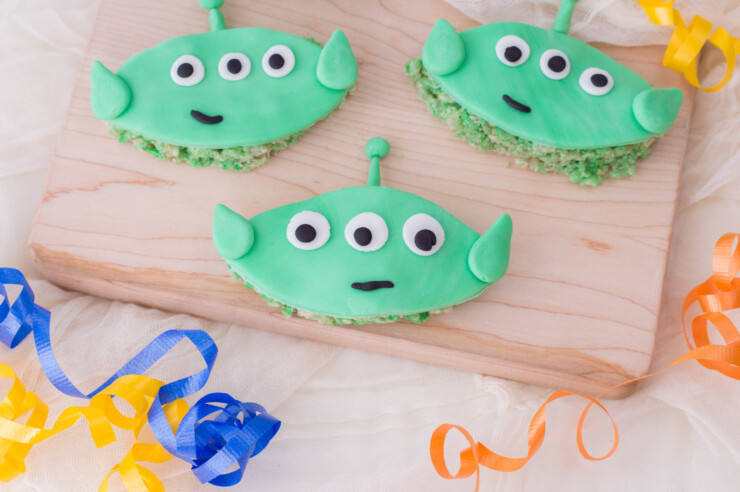 "These Toy Story Inspired Cereal Treats featuring the lovable green aliens from Toy Story. These rice crispy treats are sure to impress, and make your family say ""OooOoOoOoOohhhh!"""