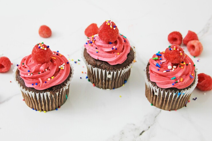 These raspberry cupcakes will take you back to summer time - they're so good, easy to make, and a real treat everyone is sure to love with a juicy, unexpected surprise inside.