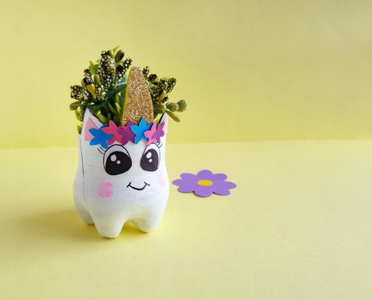 This Upcycled Unicorn Planter makes any space magical. This is a great bottle recycling craft for kids and adults alike!