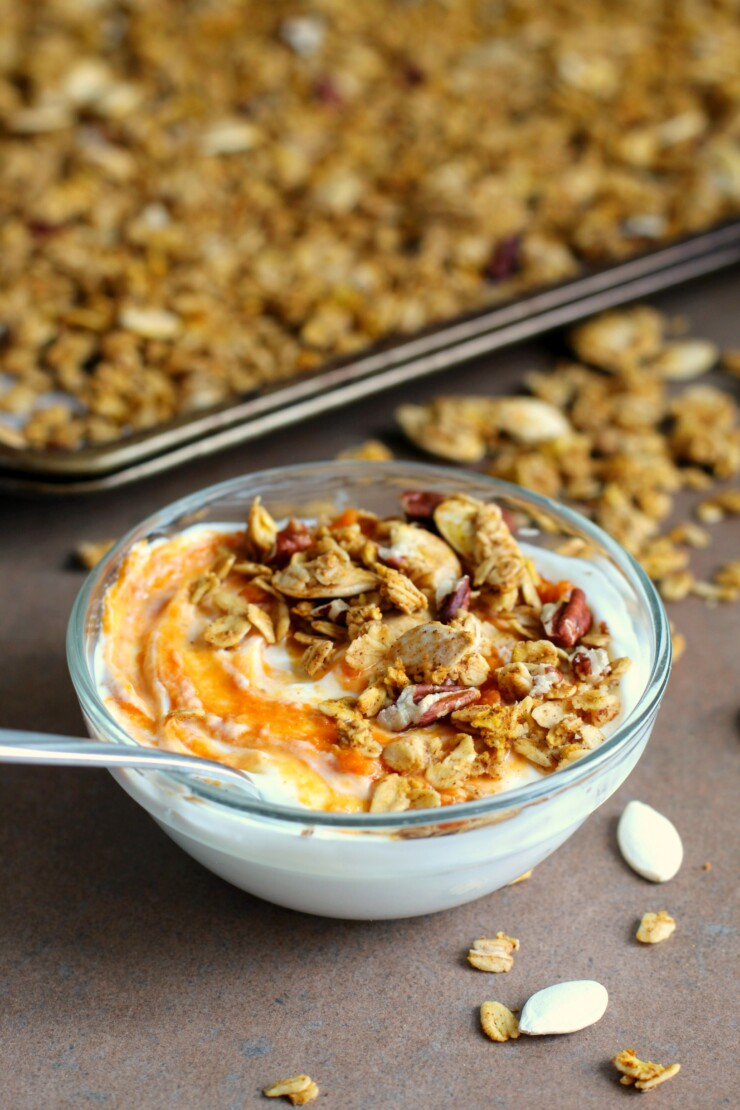 This gluten free Pumpkin Spice Granola recipe is filled with warm spices, filling granola and crunchy pumpkin seeds and pecans. Enjoy with creamy yogurt and a swirl of pumpkin pie filling for a healthy and filling fall breakfast.