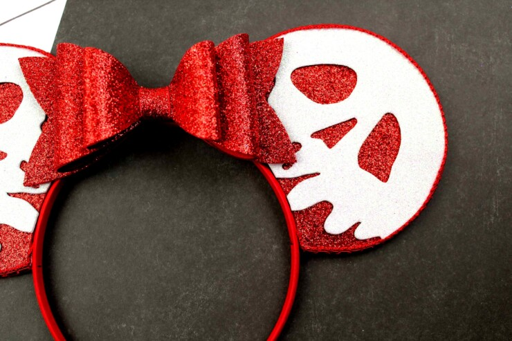 These easy to make, no-sew Evil Queen Poison Apple Mickey Ears, are perfect for Disney at night - they are perfect for Mickey's Not So Scary Halloween party! Any fan of snow white is sure to love these Mickey Ears and thanks to the free printable template included, anyone can make them.
