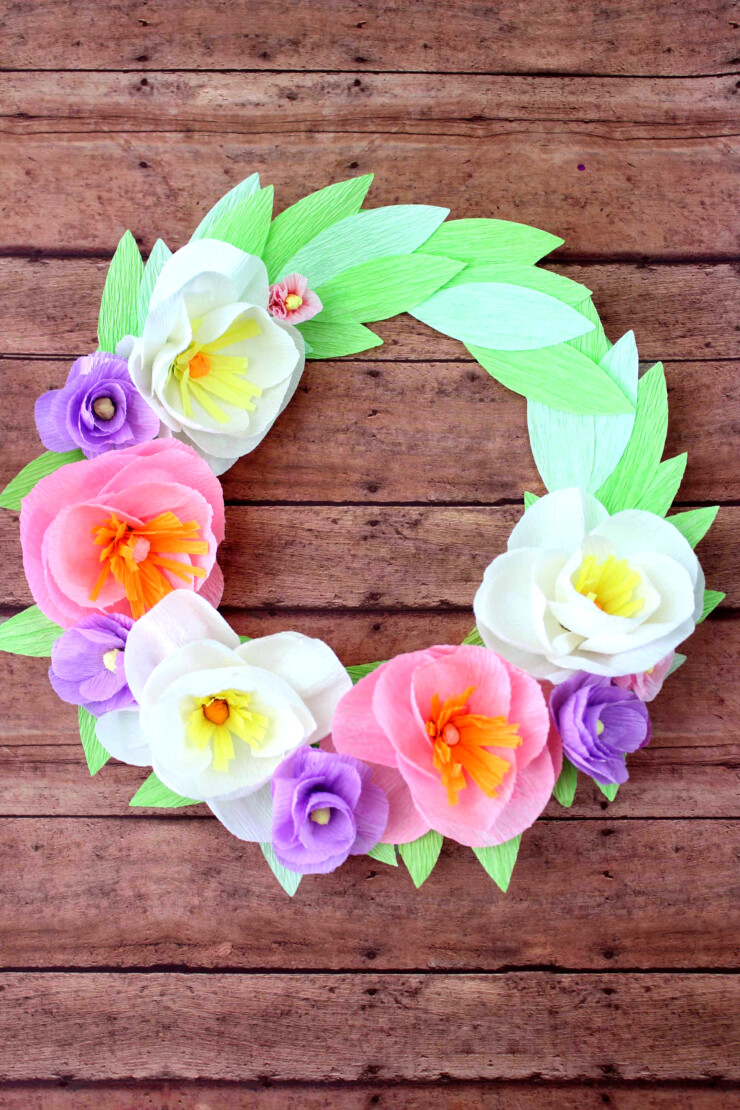 Welcome in spring with this easy and super pretty Crepe Paper Floral Wreath diy project!