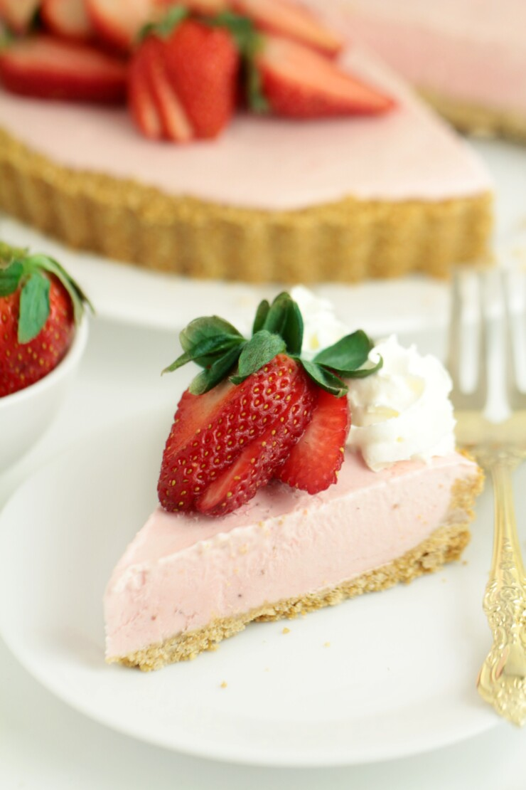 This No Bake Strawberry Cheesecake is beyond easy to make and is a great dessert year round. It features a buttery cookie crust topped off with a strawberry cheesecake filling - delicious frozen or at room temperature.