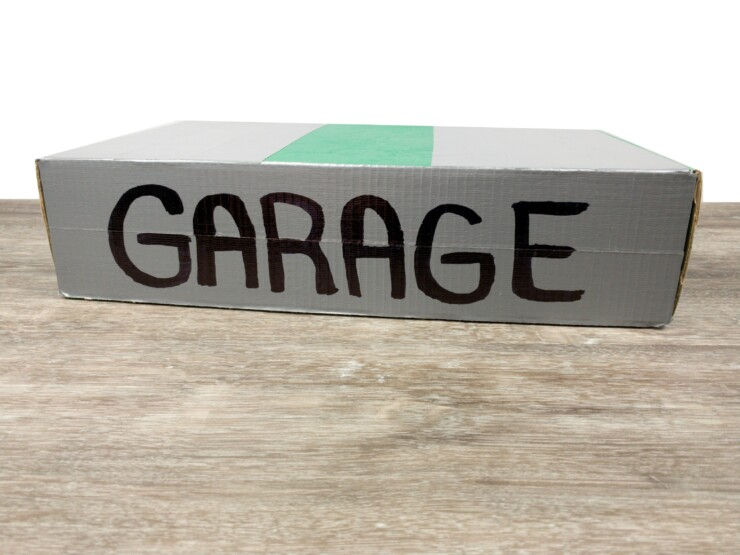 This Portable Garage with Mini Race Track is a fun DIY project to upcycle toilet paper rolls. It makes for a great handmade gift that kids will love and use for years, and the perfect way to store away all those small cars.