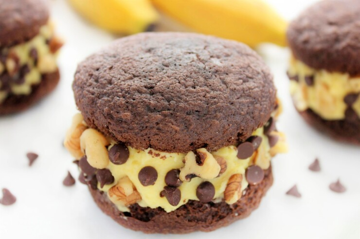 Inspired by Ben & Jerry's Chunky Monkey Ice Cream, these Chunky Monkey Whoopie Pies are a perfect treat with chocolate, banana and walnuts coming together for one amazing dessert!
