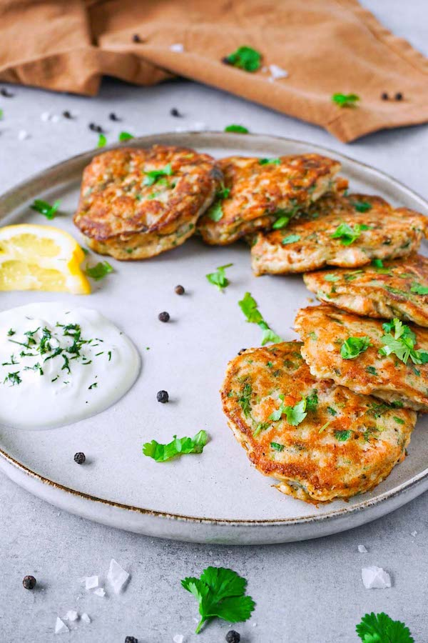 These gluten-free keto salmon cakes are juicy and with tons of flavour from fresh salmon, cilantro, and gentle heat from the chipotle pepper. It's a delicious and healthy keto dinner idea that can feed a whole family.