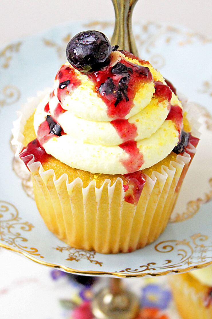 These Lemon Blueberry Cupcakes with Lemon Cream Cheese Frosting are a lemon lovers delight. They taste like summer with their light and soft texture, they're loaded with blueberries, and topped with a tangy sweet cream cheese frosting. These will definitely go in your favorites file. You're gonna' love them!