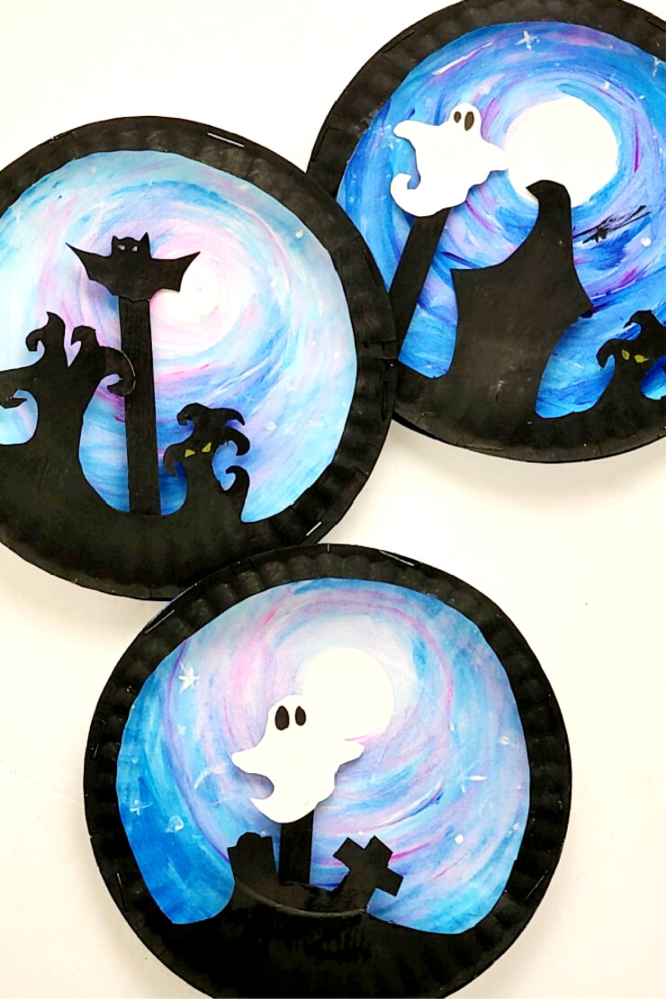 This fun Paper Plate Halloween Scene Puppet craft features a ghost or bat puppet that kids can move around a spooky backdrop. I love kids crafts that have a purpose after the craft is complete and this one really inspires imaginative play.