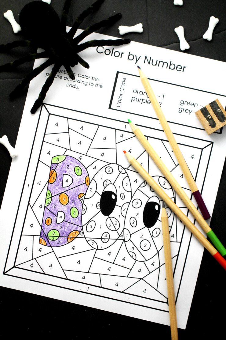 """Children will enjoycelebrating the spookiest of Holidays with these 6 Halloween Colour by Number Free Printable Sheets. Simply download the Halloween Colour by Number pack, print and watch them discover the """"hidden"""" spooky images within each design."""
