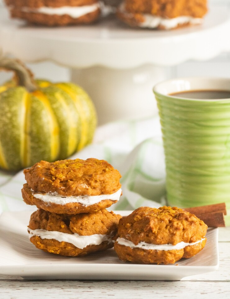 These Pumpkin Oatmeal Whoopie Pies feature super soft pumpkin oatmeal cookies sandwiched together with an incredible marshmallow filling for a family favourite fall treat.